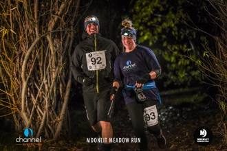 Two runners at night at the Moonlit Meadow Run