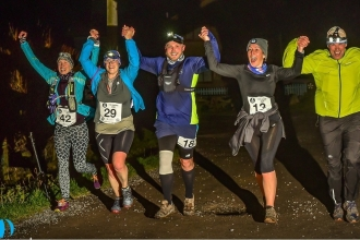 Night runners holding hands together at One Fyne Night