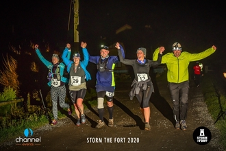 Night runners holding hands at Storm the Fort
