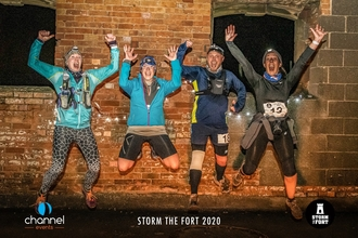 Night runners leaping in the air at Brean Fort