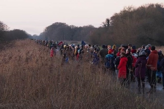 Crowds of people at Avalon Marshes waiting for starlings