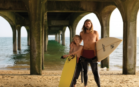 Father and son with surf boards