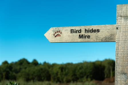 Sign at Westhay Moor pointing to the bird hides and mire