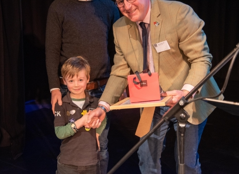 Jack Davies and his father receive the award from Graeme Mitchell, Chair of SWT