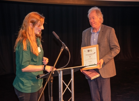 Simon Briggs receiving his award from Rhiannon Route